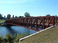 Erected by Acts II Construction:This LAFA project included the construction of a 240 foot single span pedestrian bridge spanning the Oswegatchie River connecting Harry L. Mills Memorial Park with the Riverview Recreation Park